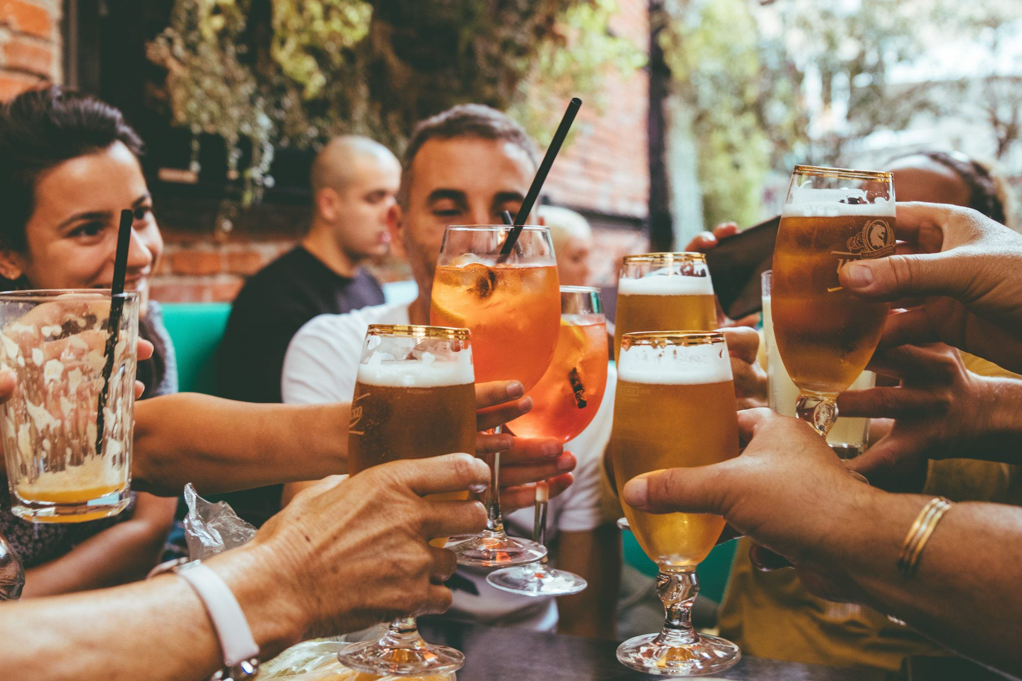people raising glasses how alcohol affects men vs women